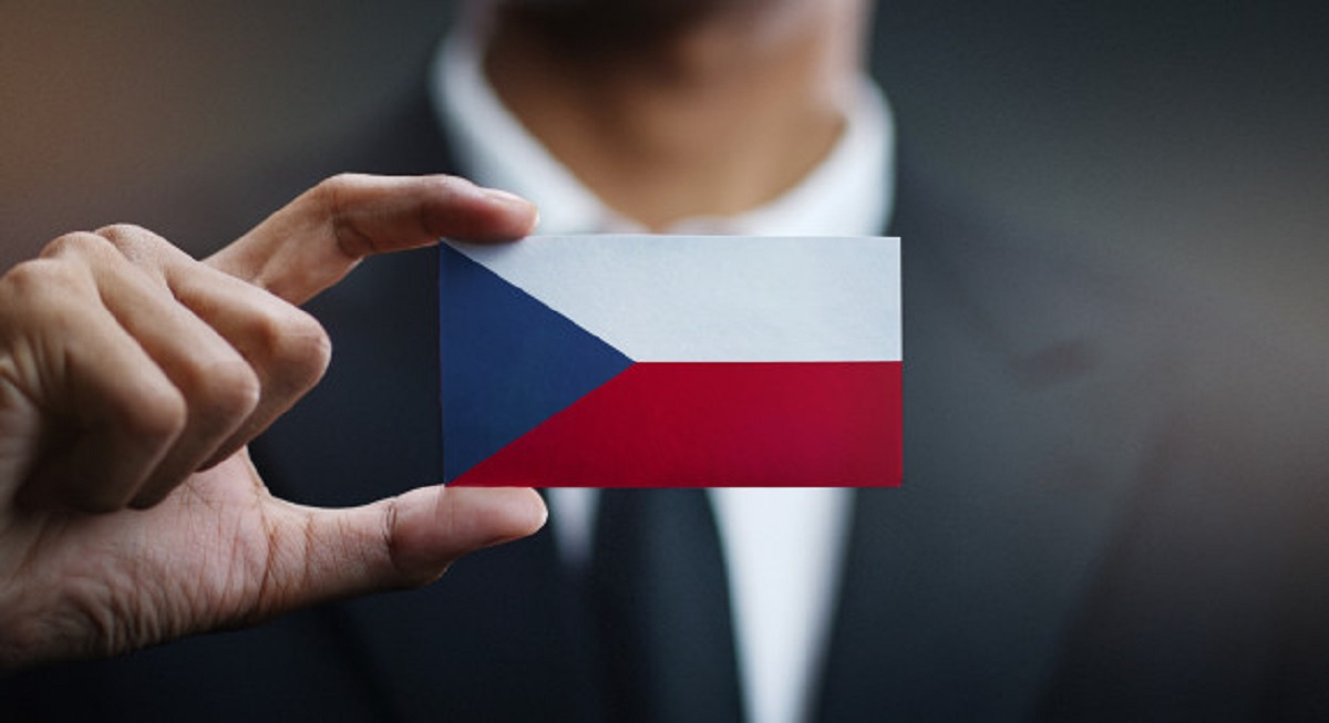 businessman-holding-card-czech-republic-flag_1379-3306