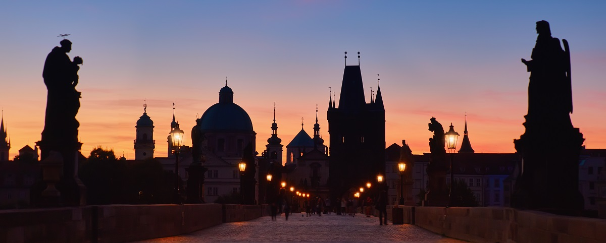Prague at night, panoramic image. Charles Bridge early in the mo