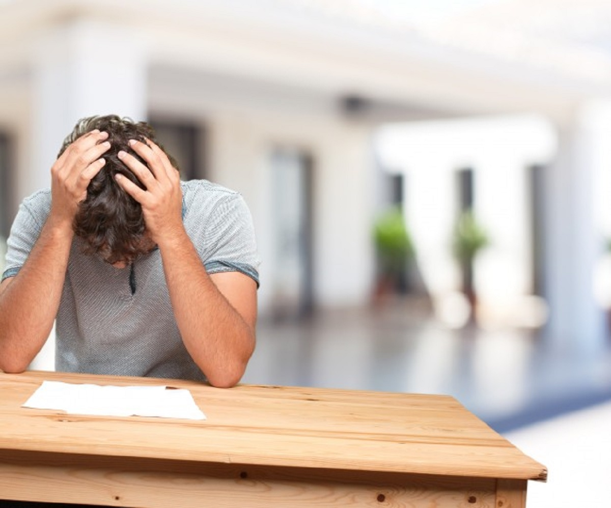 young-man-table-worried-expression_1194-4582