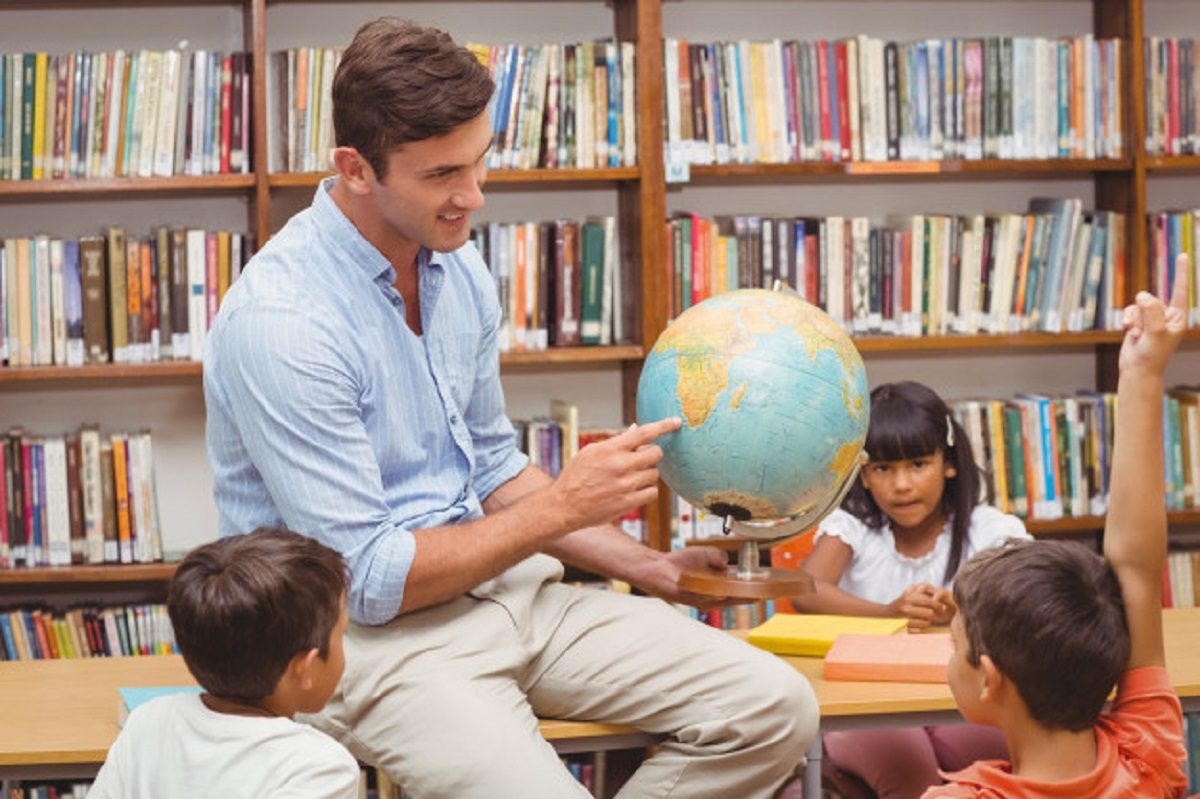 cute-pupils-teacher-looking-globe-library_13339-203540